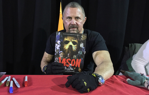 Kane Hodder with the Jason Souvenir Guide magazine from Classic Monsters