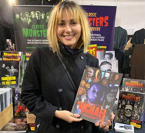 Scout Taylor-Compton with the Classic Monsters Michael guide