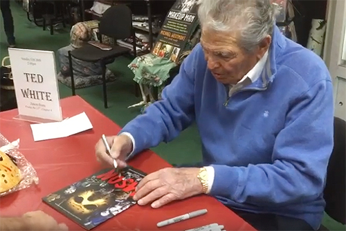 Ted White signs a copy of the Jason franchise guide